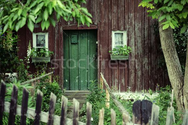 Old house with a deep green door Stock photo © konradbak