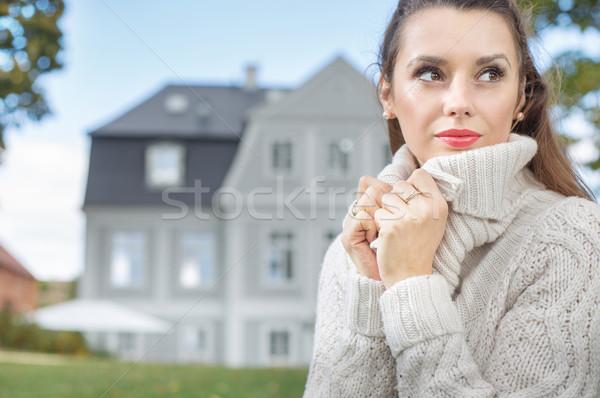 Pretty lady wearing thick sweater Stock photo © konradbak