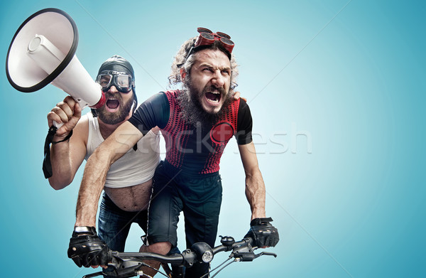 Two hilarious cyclists involved in a contest Stock photo © konradbak