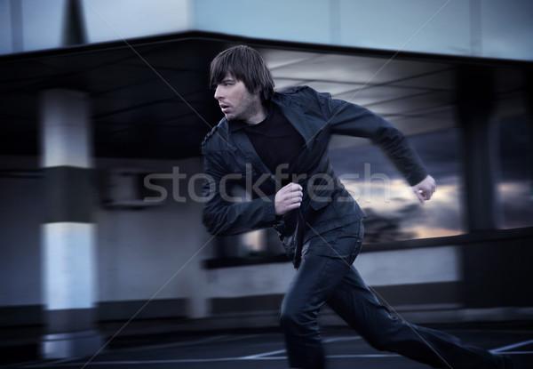 Elegante zakenman lopen man team jeans Stockfoto © konradbak