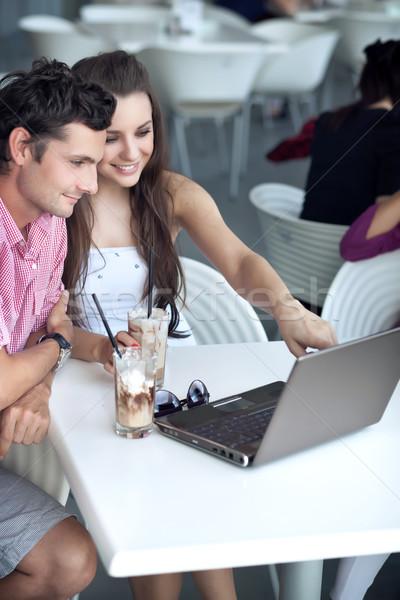 Loving couple browsing internet in a restaurant Stock photo © konradbak