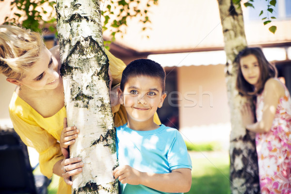 Attractive mother looking after her children Stock photo © konradbak