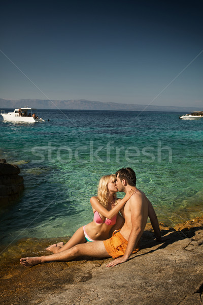 Lovely couple kissing near the seaside Stock photo © konradbak