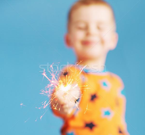 Blurred portrait of boy holding a sparkler Stock photo © konradbak