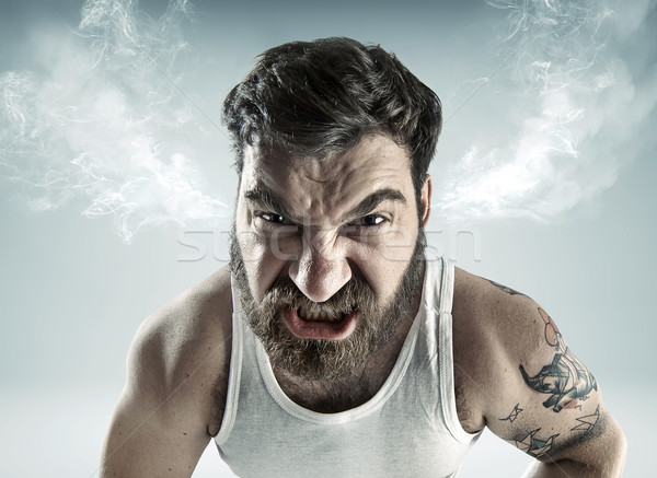 Portrait of a really mad man Stock photo © konradbak