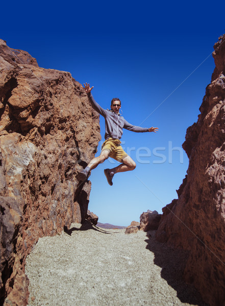 Athletic guy running on the desert Stock photo © konradbak