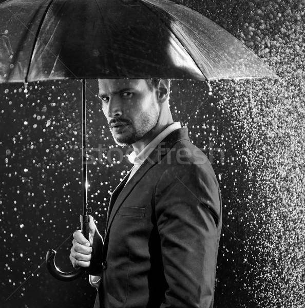 Black&white portrait of a businessman posing in the middle of th Stock photo © konradbak