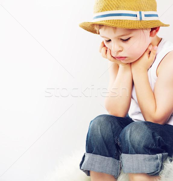 Sad boy with his straw hat Stock photo © konradbak