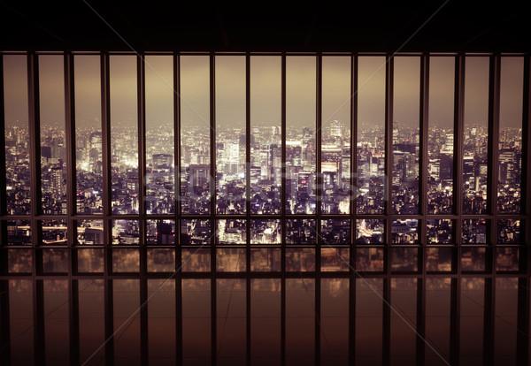 Night city behind the grating Stock photo © konradbak