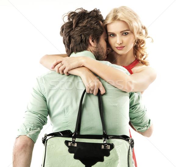 Handsome man hugging a sensual woman Stock photo © konradbak