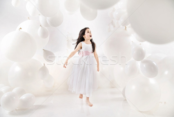 Delighted girl among numerous balloons Stock photo © konradbak