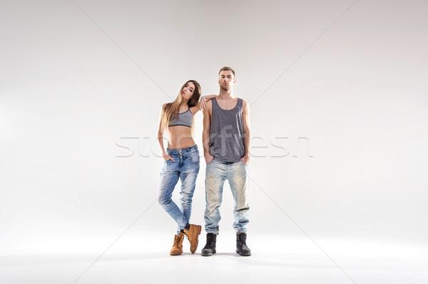 Sporty hip-hop couple isolated over the white background Stock photo © konradbak