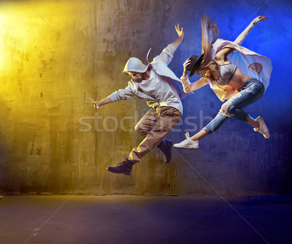 Stylish dancers fancing in a concrete area Stock photo © konradbak