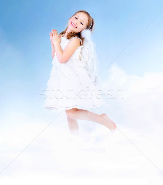 Ange enfant fille blanche ailes Kid Photo stock © konradbak