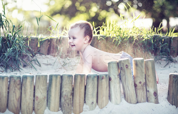 Small boy playing in the sandpit Stock photo © konradbak