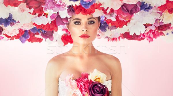 Pretty young woman wearing colorful chaplet Stock photo © konradbak