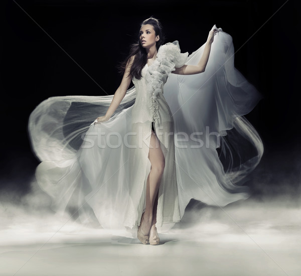 Sensual brunette woman in white dress Stock photo © konradbak