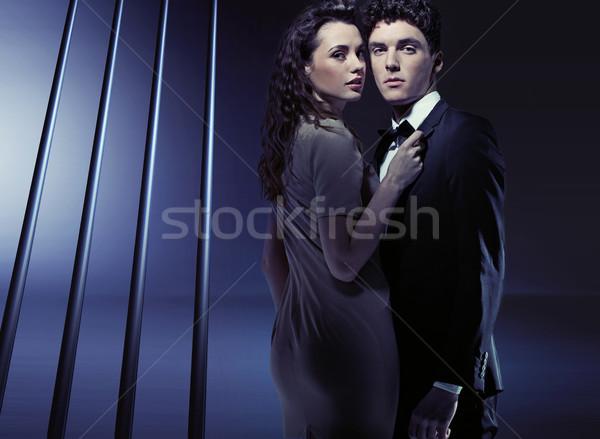 Sensual woman holding her boyfriend very close Stock photo © konradbak