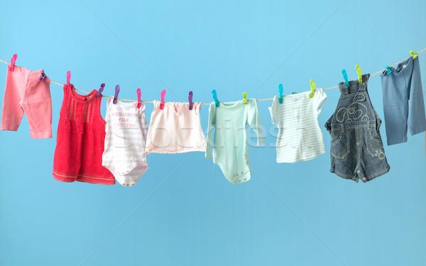Colorful baby's clothes getting dry Stock photo © konradbak