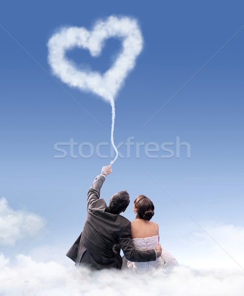 Just married couple sitting on the cloud Stock photo © konradbak