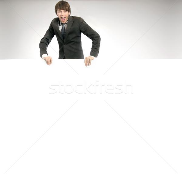 Fiatal menedzser tart üres fehér tábla papír Stock fotó © konradbak