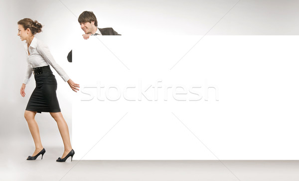 Business people pulling big white board, lots of copyspace Stock photo © konradbak