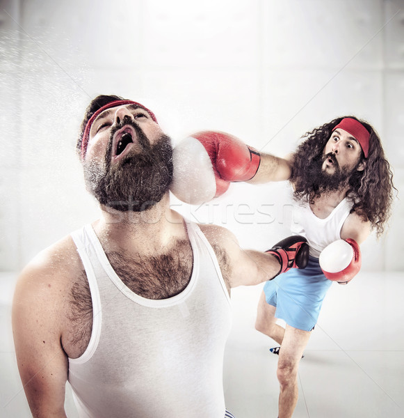 Two nerdy guys boxing on the ring Stock photo © konradbak