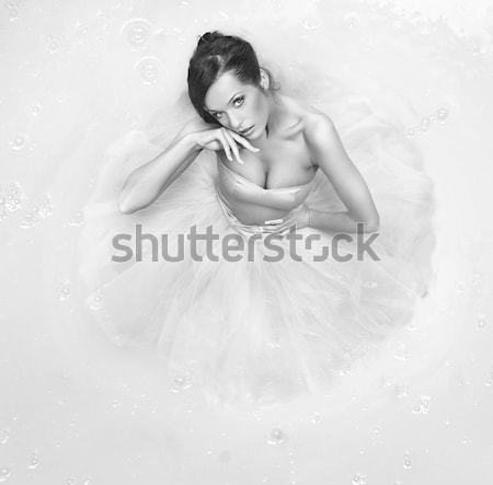 Portrait of an attractive blond lady wearing a fabulous gown Stock photo © konradbak
