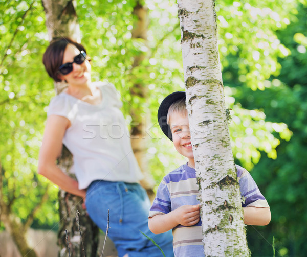 Smiling mother looking after her son Stock photo © konradbak