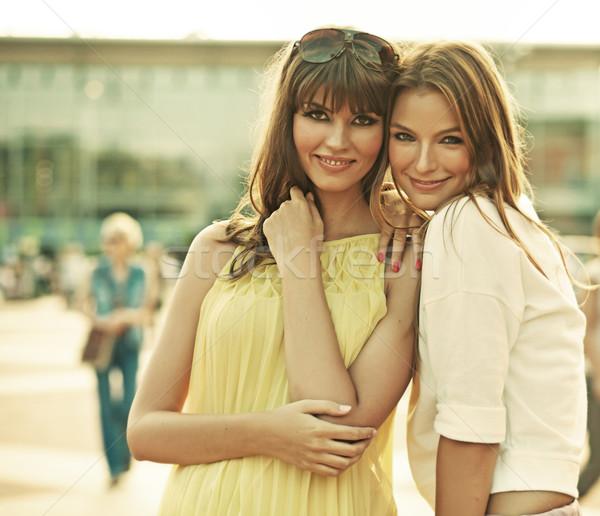 Two smiling girlfriends with summer make-up Stock photo © konradbak