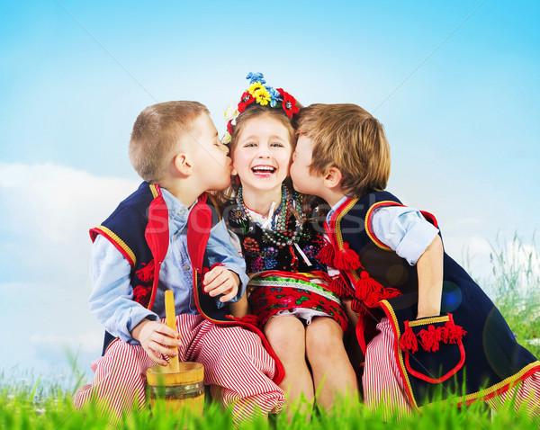 Three cheerful kids wearing national costumes Stock photo © konradbak