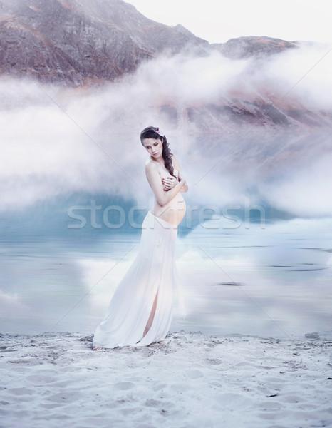 Pretty pregnant nymph on the lake beach Stock photo © konradbak