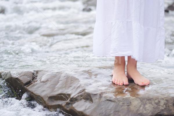 Girl soaking feet in stream Stock photo © konradbak