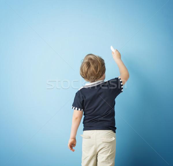 Cute boy writing with chalk Stock photo © konradbak