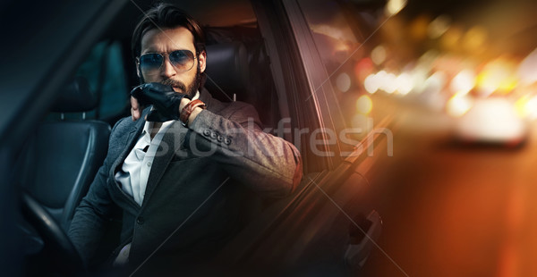 Outdoor portrait of fashion man driving a car Stock photo © konradbak