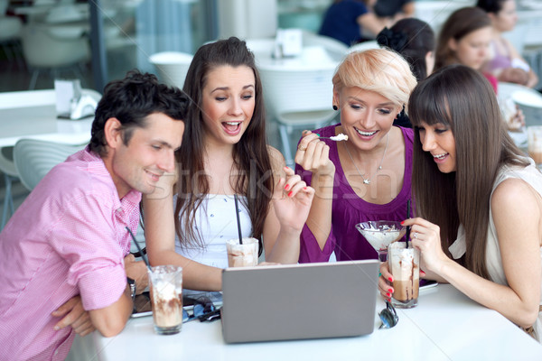 Young people browsing internet in a restaurant Stock photo © konradbak