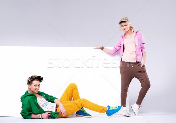Alegre adolescentes suelto ropa atractivo hombre Foto stock © konradbak