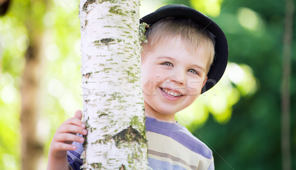 Cheerful boy hiding himself in the garden Stock photo © konradbak