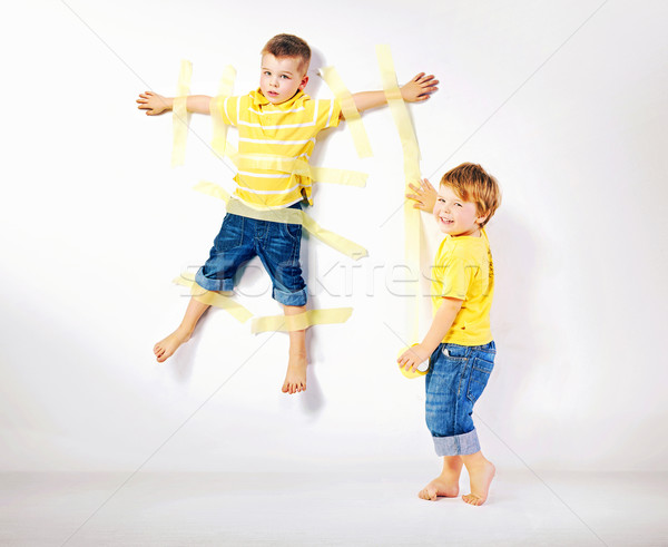Stock photo: Two smiling brothers playing together