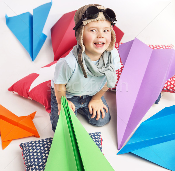 Small cute boy with plenty toy planes Stock photo © konradbak