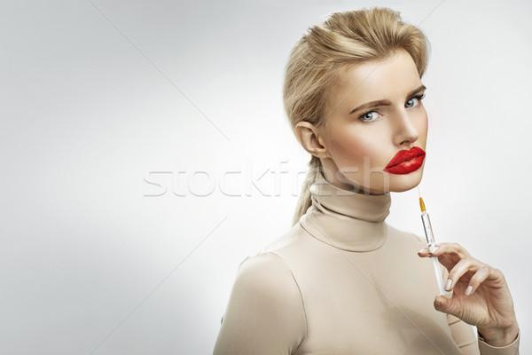 Eltúlzott injekció ajkak gyönyörű szőke nő szőke Stock fotó © konradbak