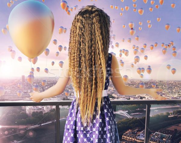 Little girl looking at the thousands of balloons Stock photo © konradbak