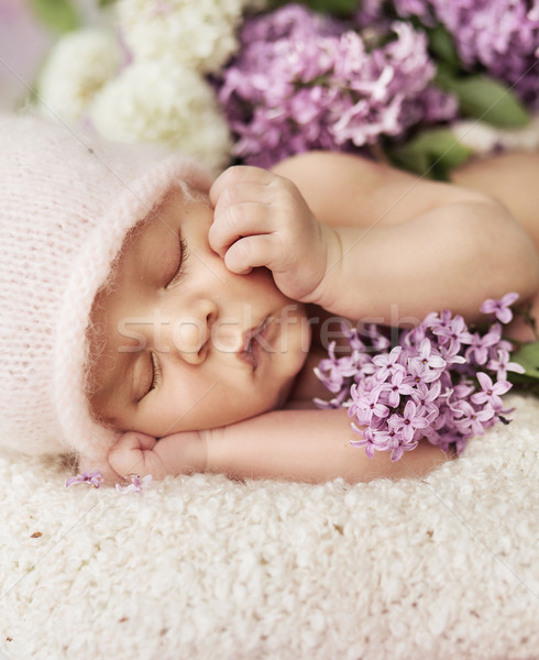 Cute newborn child sleeping on the carpet Stock photo © konradbak