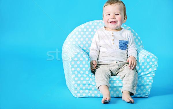 Little boy sitting on the toy armchair Stock photo © konradbak