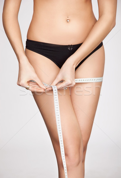 woman measuring her shape Stock photo © konradbak