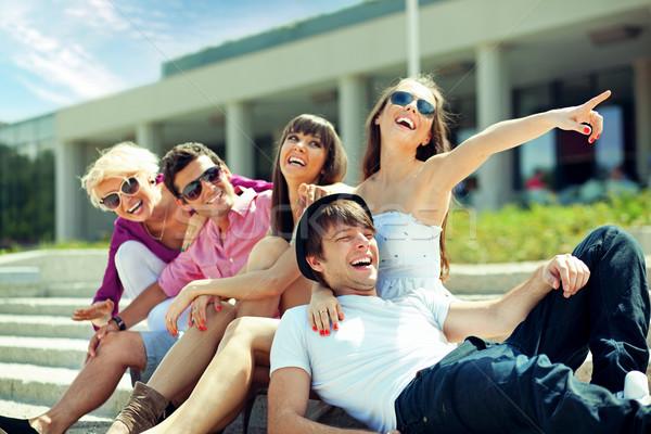 Group of cheerful friends Stock photo © konradbak