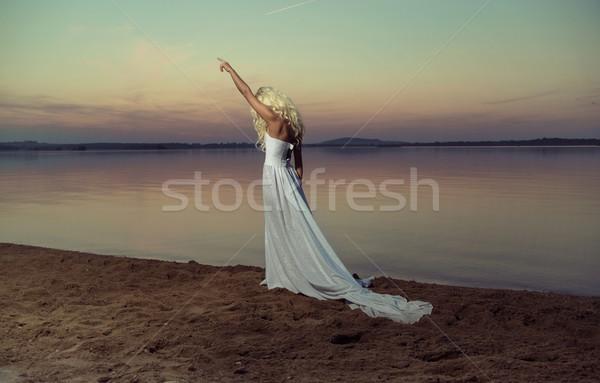 Blond woman walking on the beach Stock photo © konradbak