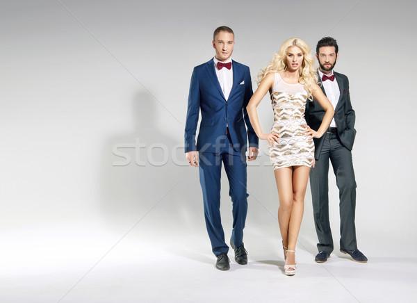 Portrait of three classy people Stock photo © konradbak