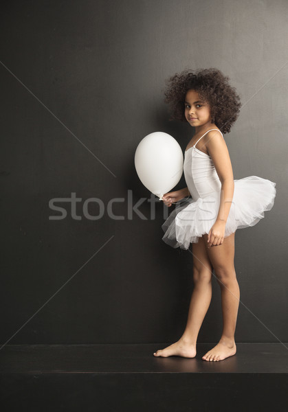 Conceptual picture of a little ballet dancer with a ballon Stock photo © konradbak