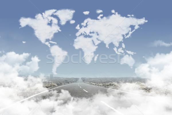 Dense clouds in the world shape above the rural road Stock photo © konradbak